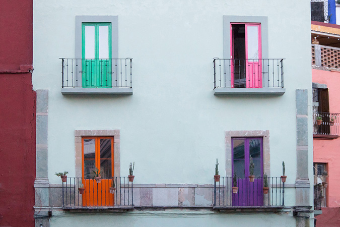 Colorful doors on a white building