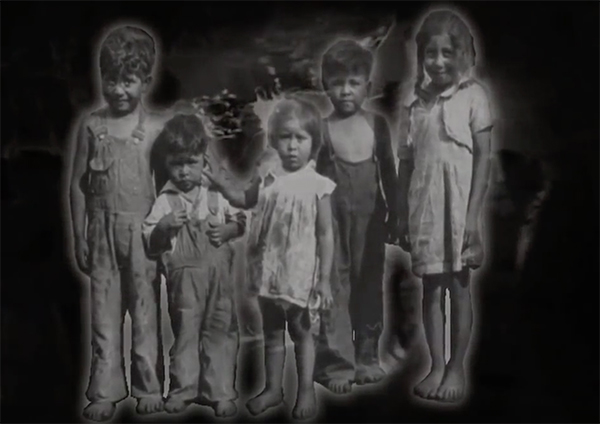 Native American children standing together.