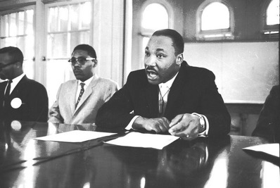 King is seen here speaking at a press conference held at Shaw University in Raleigh, 15 April 1960.