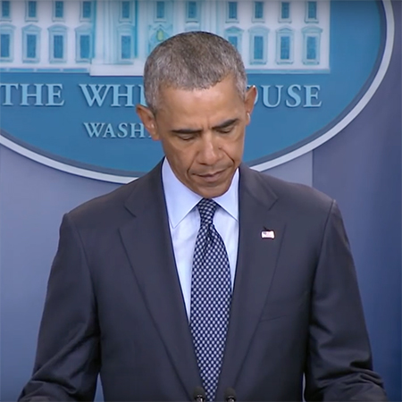 President Obama standing at the podium giving a speech.