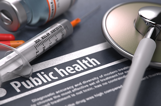 Document stating public health pictured with syringe needle, medicine and stethoscope