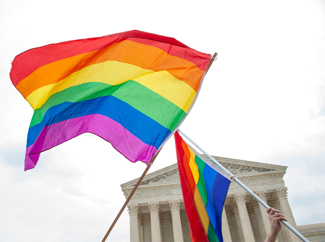 Two pride flags waved in front of Supreme Court