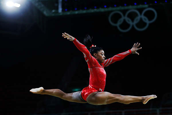 Simone Biles doing splits in the air