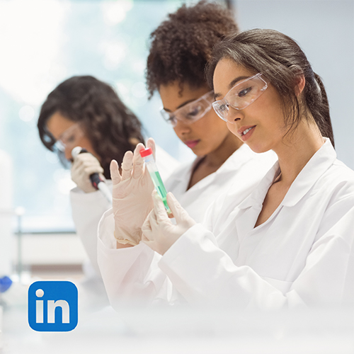 Three women in a lab performing research.