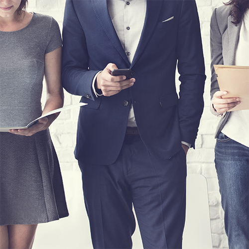 Two women and a man dressed in business casual.