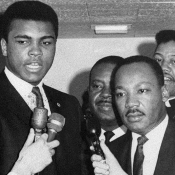 Dr. Martin Luther King, Jr and Muhammad Ali speaking with reporters.
