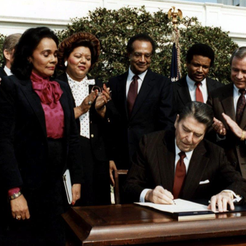President Ronald Reagan signs the MLK Holiday into law.