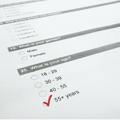 Closeup of a survey form with 55+ checked.