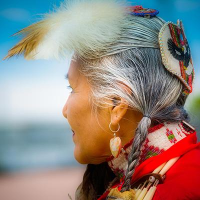 Closeup of Native American elder woman in traditional garb looking at the landscape