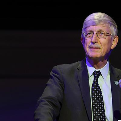 Dr. Francis Collins standing at a podium speaking at an event.