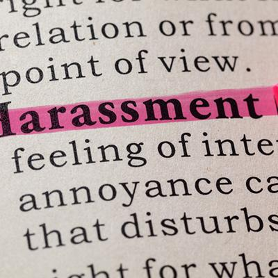 Harassment highlighted in pink with incomplete text of its definition.