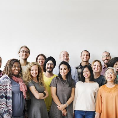 A diverse team of people posing for a group photo.