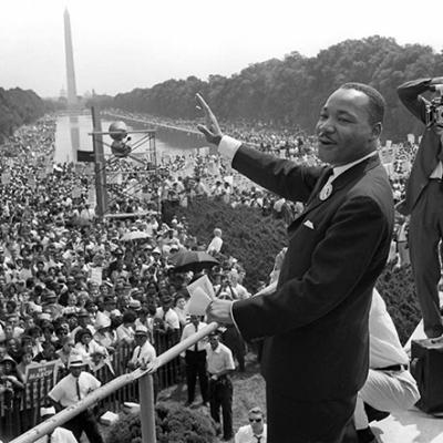 Dr. Martin Luther King, Jr. waving to the crowd at the March on Washington.